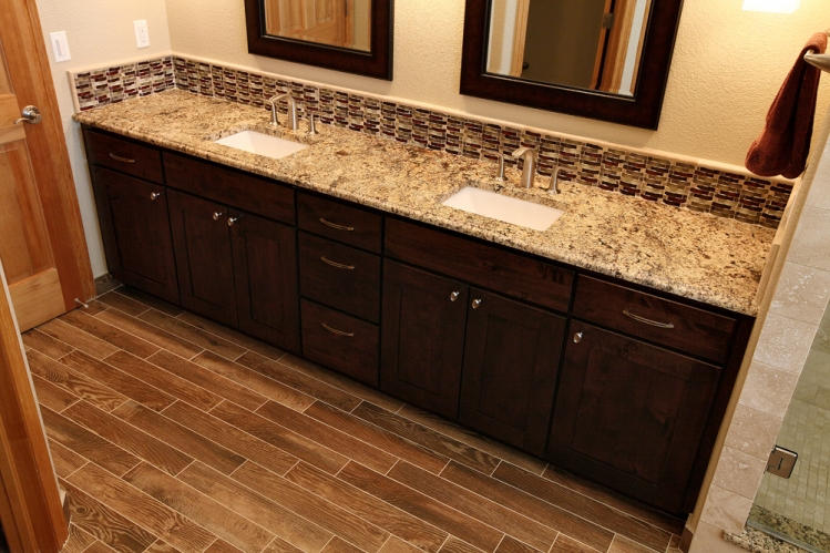 tile floors, tub surround with tile, granite material for tub and vanity countertops, glass mosaic insert